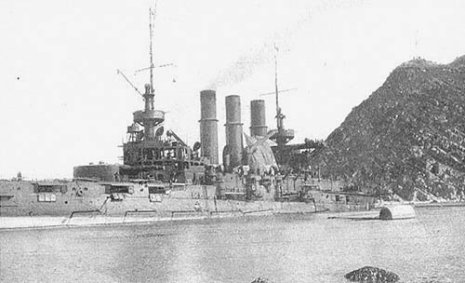 Russian battleship Retvizan on the rocks at Port Arthur Harbor entrance.